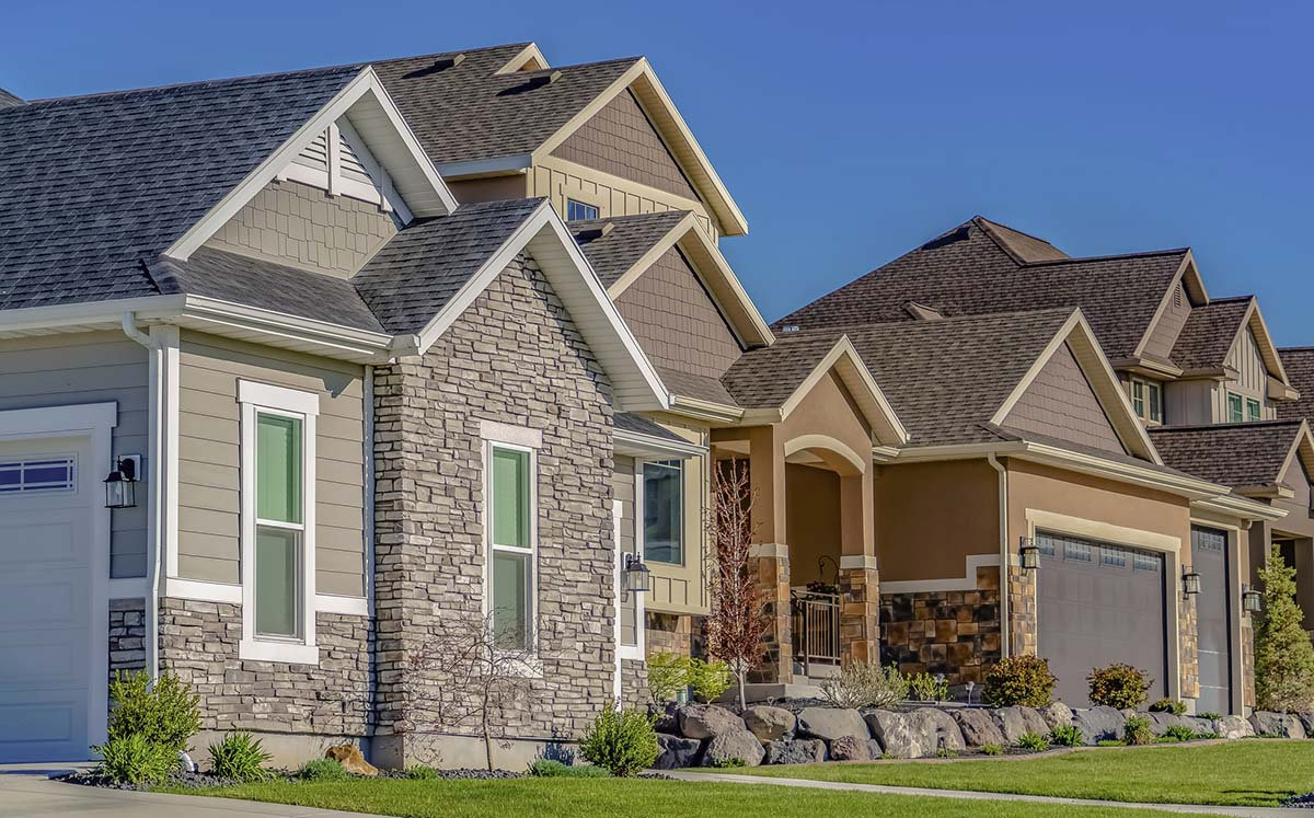 Row of newly constructed houses seen while performing home inspection services